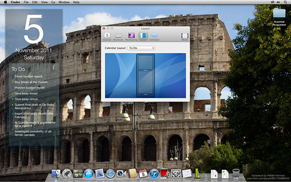 Blotter calendar over a desktop background of Rome.